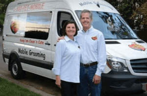 Picture Of Couple in front of Aussie Pet Mobile Van.